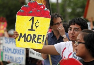 Eighteen-year-old Orlando Cervantes, of Immokalee, protests with other Coalition of Immokalee Workers supporters and staff near the Publix at the intersection of Immokalee Road and Collier Boulevard on Thursday, March 31, 2011, in Naples. On the birthday of legendary farmworker leader Cesar Chavez, the protestors sought to bring attention to their organization's ongoing demands for Publix to commit to a code of conduct to protect the rights of farmworkers. David Albers/Staff